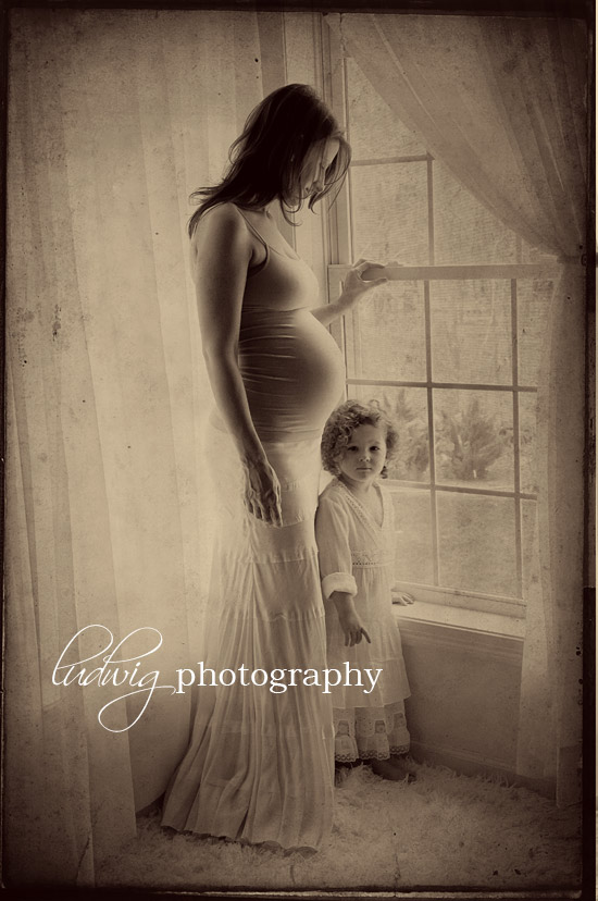 artistic portrait of mommy and daughter